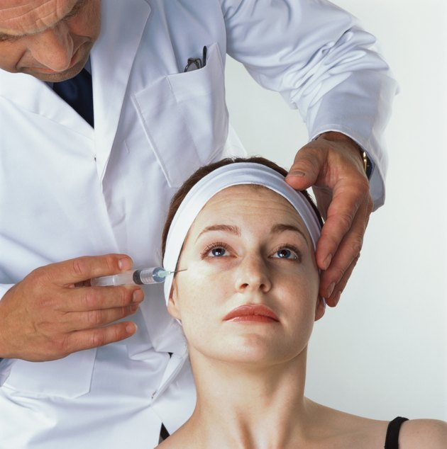 woman receiving an injection by her eye