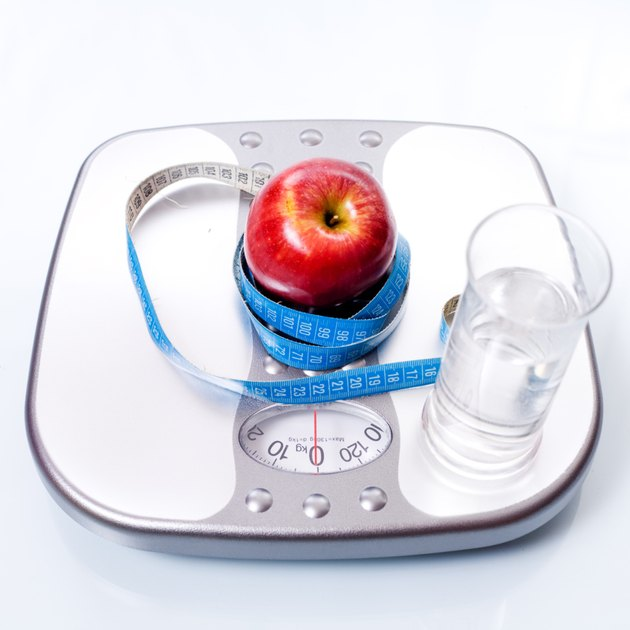 Weight scale ,apple and glass of water