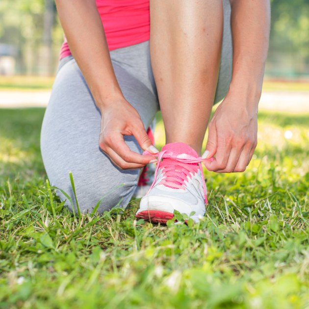 Fitness Woman Tying Shoelaces