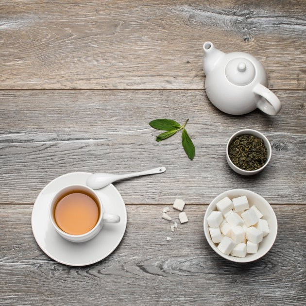 Green tea on a wooden table.