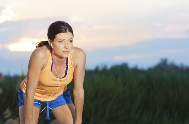 Female Runner finishing a run