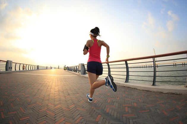 young fitness woman runner running at seaside