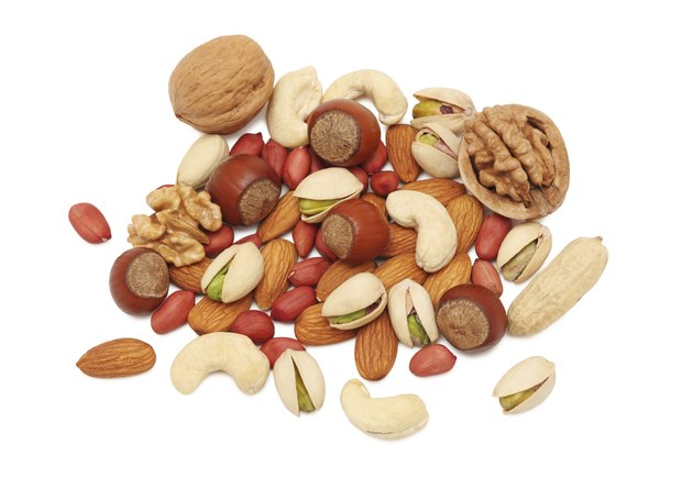 Pile from different kinds of nuts (isolated)