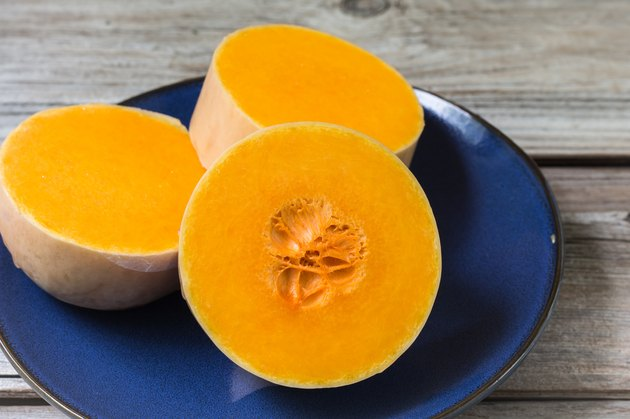 three thick slices of butternut squash in blue plate.