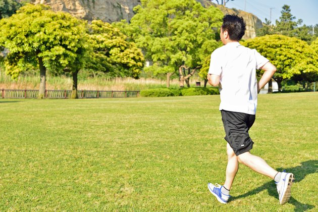 Japanese middle age man running in a park