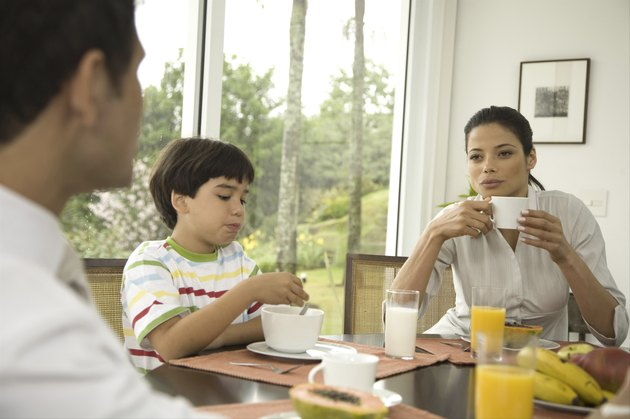 Family including boy (8-9) having breakfast