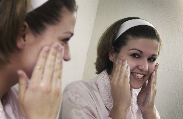 Teen washing her face w/ soap