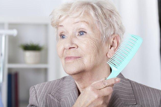 Senior lady combing hair
