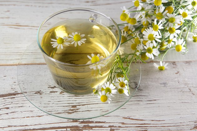 cup of chamomile tea with flowers