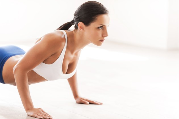 Woman doing push-ups.