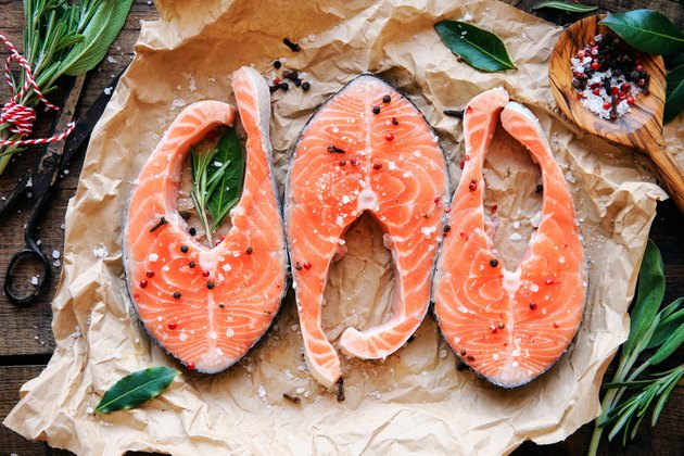 Raw salmon steaks with herbs
