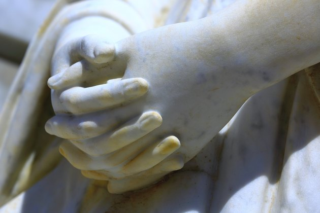 Detail of marble Virgin Mary praying hands