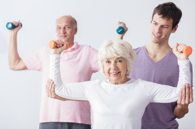 Personal trainer and elderly couple