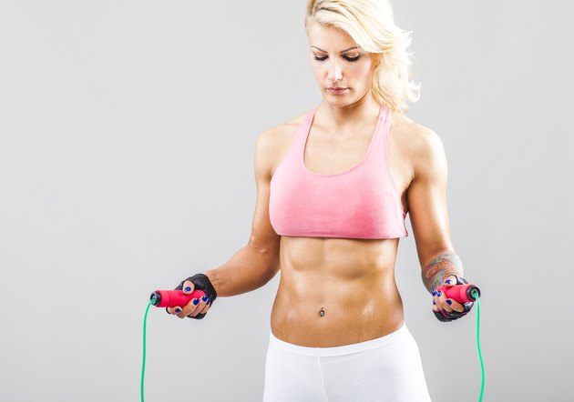 Fitness girl holding jumping rope