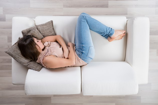 Young Woman Napping On Sofa
