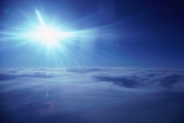 Aerial view of bright sun over cloud blanket