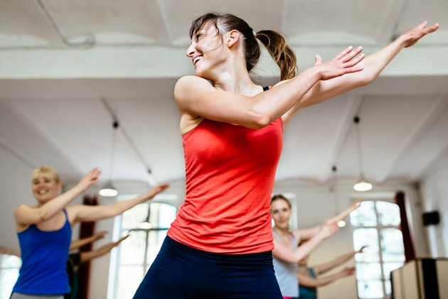 Female Trainer Infront Of Her Aerobics Class