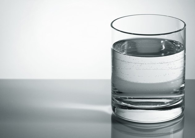 Grey water glass with bubbles