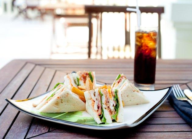 Club sandwich with iced soda drink