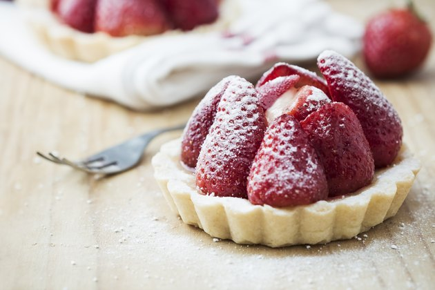 Strawberry tart on wooden table