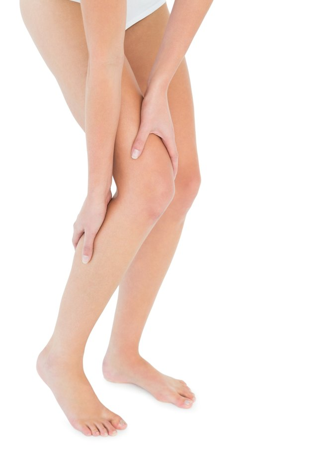 Close-up low section of a fit woman with leg pain
