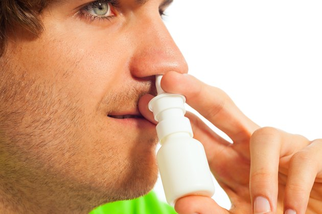 Young man with nasal spray