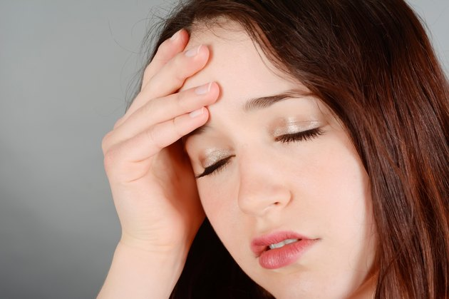Young woman having head ache