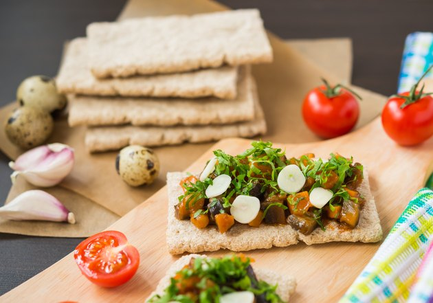 Healthy food. Appetizer. Crispbread with steamed vegetables (eggplant, carrot, onion)