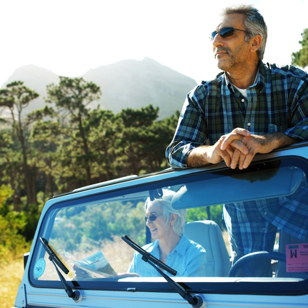 mature couple in a jeep in the woods