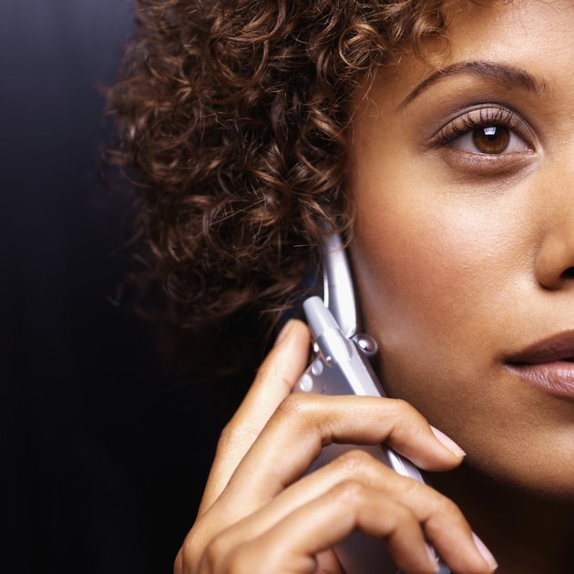 Close-up of a young businesswoman using a mobile phone