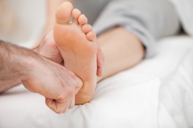 Ball of a foot being touched by a doctor
