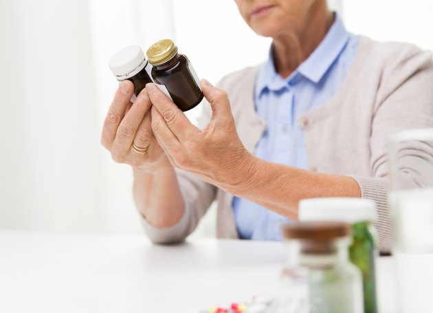 close up of senior woman with medicine jars