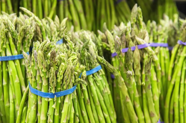 bunch of fresh asparagus from market shelves real