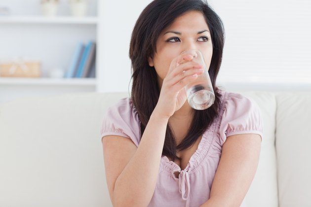 Woman drinking from a glass of water