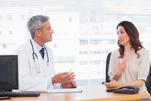 Patient talking with her doctor about illness