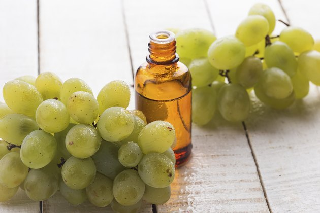 Fresh grape and  seed oil in bottle