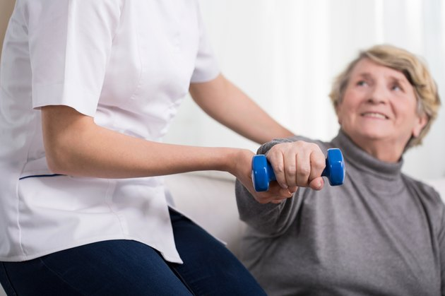 Woman and physiotherapist's help