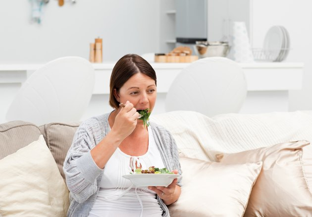 Pregnant woman eating vegetables
