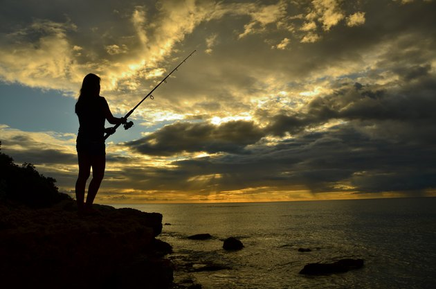 Fishing while standing on a cliff in Hawaii