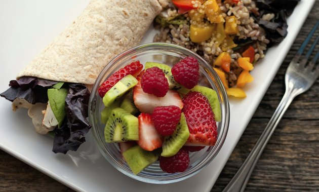 Healthy lunch chicken wrap with fruit and wild rice