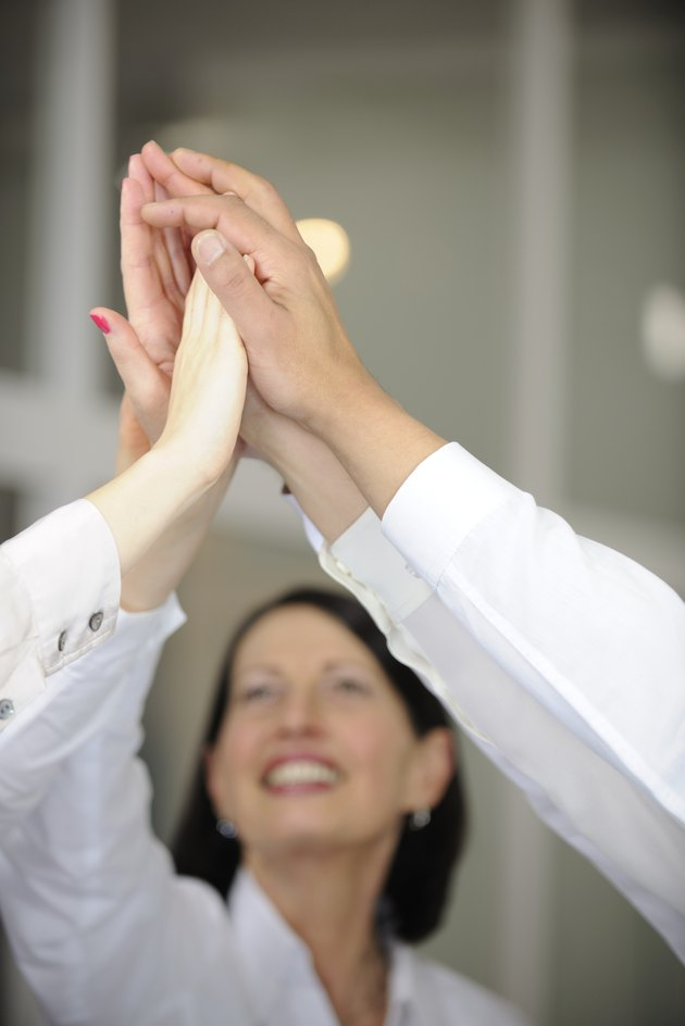 Business team giving high five