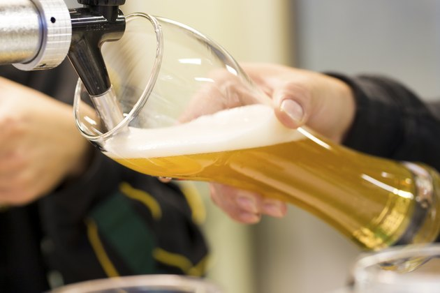 Pouring Draft Beer into Weizen Glass