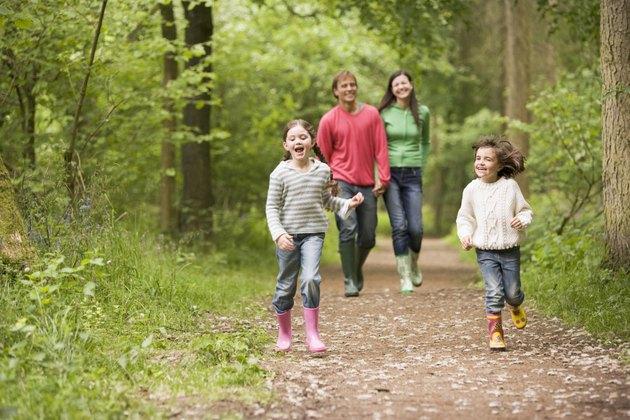 Family walking on path smiling