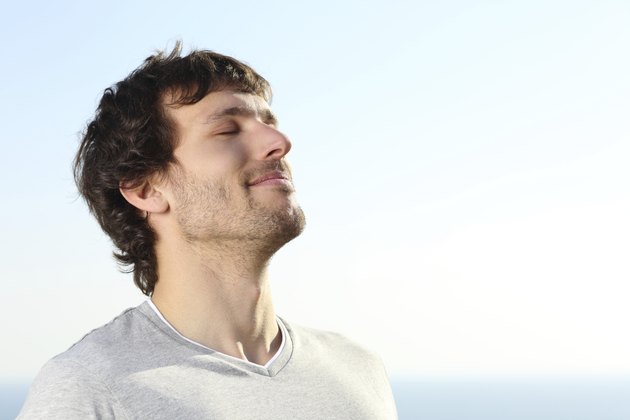 Close up of a man doing breath exercises outdoor