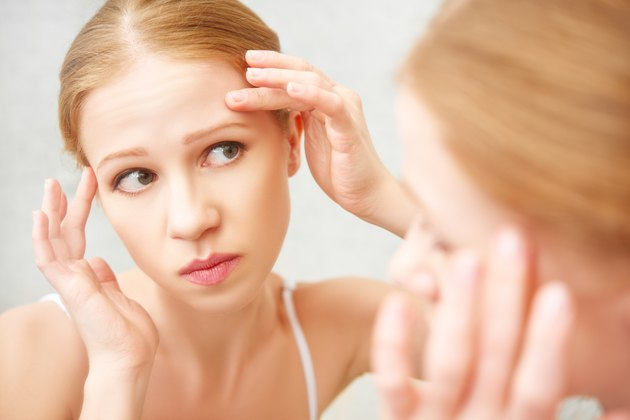 beautiful healthy woman  frightened saw in the mirror acne
