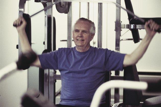Senior man exercising on a machine
