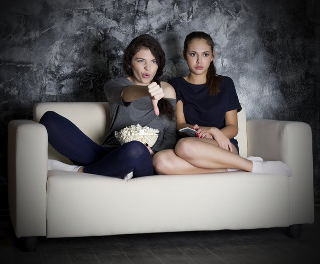 Two young girl looks TV