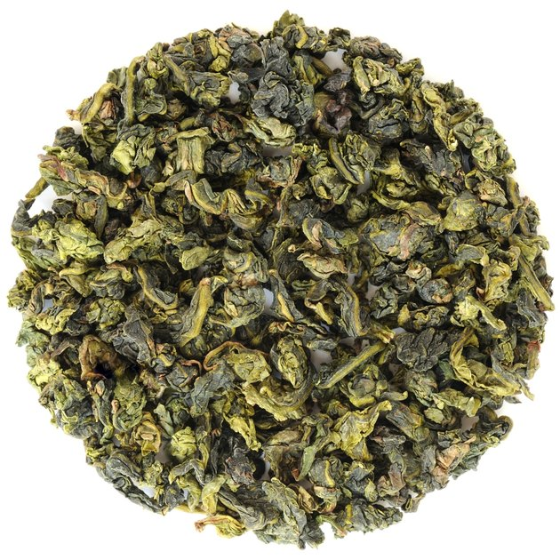 Oolong Fujian Anxi Benshan in round shape isolated