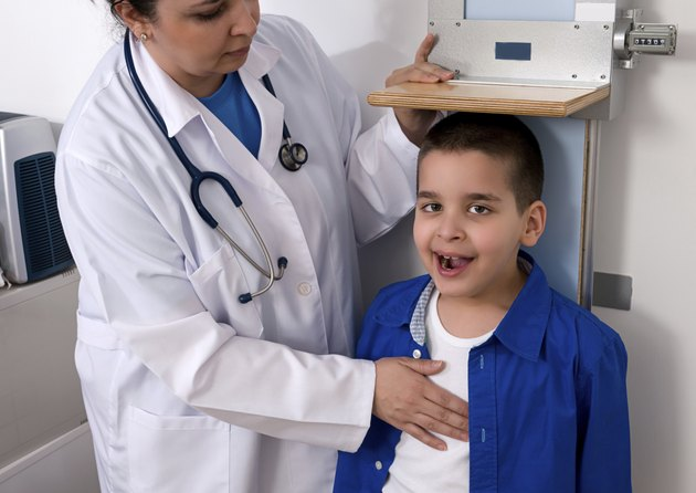 Doctor Measuring Height