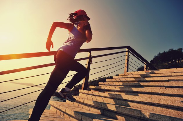healthy lifestyle asian woman running at stairs seaside